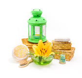 Spa concept.Yellow lily flower and objects for spa procedures Royalty Free Stock Photo