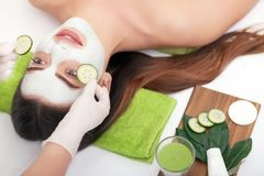 Spa concept. Young woman with nutrient facial mask in beauty sal. On, close up Royalty Free Stock Photos