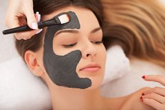 Spa concept. Young woman with nutrient facial mask in beauty sal. On, close up stock photos