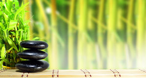 Spa concept zen. Basalt stones with bamboo Royalty Free Stock Image