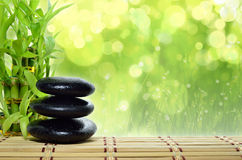 Spa concept zen. Basalt stones with bamboo Royalty Free Stock Photos