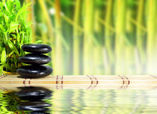 Spa concept zen. Basalt stones with bamboo Stock Photo