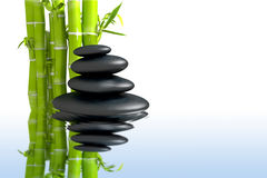 Spa concept zen basalt stones with bamboo Stock Image