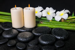 Spa concept of zen basalt stones, three white flower frangipani Royalty Free Stock Photos