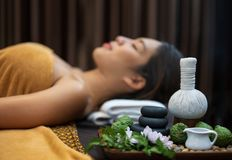 Spa concept, Zen stones, Candles and flowers on the background of woman receiving treatment, Young beautiful woman in spa stock images