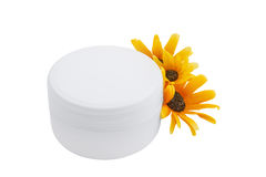 Spa cosmetic cream and flowers isolated on white Stock Photos