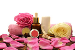 Spa cosmetics. With pink and yellow roses Stock Photos