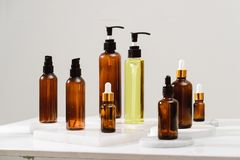 Spa cosmetics in brown glass bottles on gray concrete table.  stock images