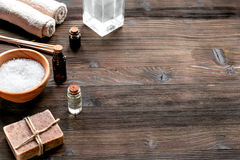 Spa cosmetics set with soap, salt, oil space for text Stock Photos