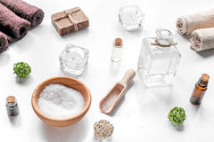 Spa cosmetics with soap, salt, oil, towels, candles on white background Royalty Free Stock Image