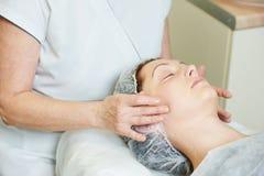 Spa cosmetologist applying facial mask Stock Photography
