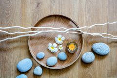 Spa decor for chic ayurveda with flow of stones and candle Royalty Free Stock Photo