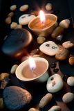 Spa decoration in asian style with stones and candle Royalty Free Stock Photos