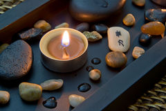 Spa decoration in asian style with stones and candle Stock Image