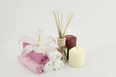 Spa decoration with candles, towels and aromatherapy oil bottle Stock Image