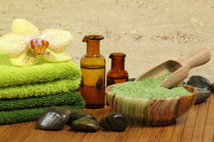 Spa detail. Spa resort composition - bath soap, towels, orchid flower, bottles with lotions Royalty Free Stock Images