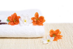 Spa detail. Towel and flowers Royalty Free Stock Photography