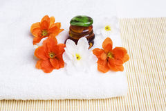 Spa detail. Towel and flowers with stones Royalty Free Stock Photos