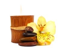 SPA elements. Composition of SPA elements: stone cairn, bamboo candle and flower Royalty Free Stock Images