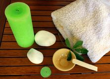 Spa elements. Aromatic lime candles, white spa stones and refreshing facial mask Stock Image