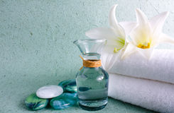 Spa elements. Zen stones with spa with candles on a bluw background Stock Images