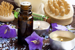 Spa essence bottle and candles Stock Images