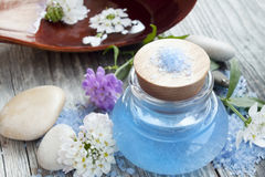 Spa essence bottle, flowers and sea salt Royalty Free Stock Photography