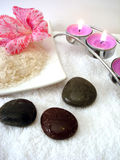Spa essential. (candles, salt, towel, flower and stones stock photo