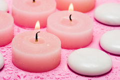 Spa essential. Candles and pebbles stock photos