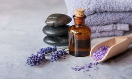 Lavender essential oil and stone spa. SPA, essential oil with lavender flowers - health and beauty, stone spa royalty free stock images