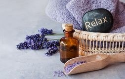 Relax spa lavender oil. SPA, essential oil with lavender flowers - health and beauty, stone spa royalty free stock image