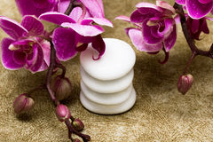 Spa essentials. (pyramid of stones with purple orchids stock photo