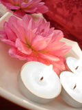 Spa essentials. (candles and pink flowers on water Stock Photography