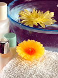 Spa Essentials. Aromatherapy candle, towel and lotions Royalty Free Stock Photos