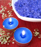 Spa essentials (blue salt, candle and flower) stock photos