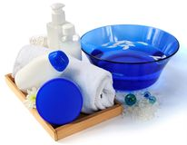 Spa essentials in blue and white color. Spa essentials with sea salts for relaxation in blue and white color Stock Photos