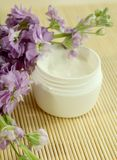 Spa essentials. Cream and flowers. Stock Images