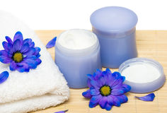 Spa essentials, cream and towel Stock Image