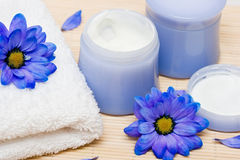 Spa essentials, cream and towel Stock Photos