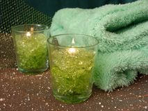 Spa essentials (green candles and towels) royalty free stock photos