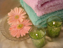 Spa essentials (green candles and towels with flowers) stock photo