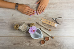 Spa essentials for a manicure. Spa beauty essential on wooden background Royalty Free Stock Image
