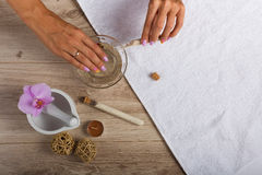 Spa essentials for a manicure. Hand spa essential on wooden background. Beauty concept Stock Images