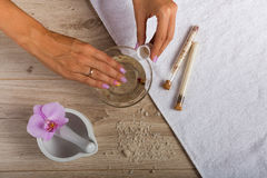 Spa essentials for a manicure. Hand spa essential on wooden background. Beauty concept Royalty Free Stock Image