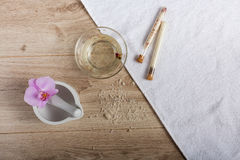 Spa essentials for a manicure. Hand spa essential on wooden background. Beauty concept Royalty Free Stock Photos