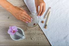 Spa essentials for a manicure. Hand spa essential on wooden background. Beauty concept Stock Image