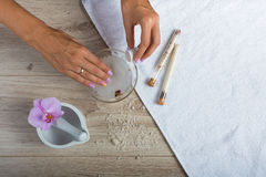 Spa essentials for a manicure. Hand spa essential on wooden background. Beauty concept Royalty Free Stock Images