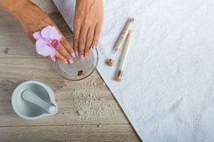 Spa essentials for a manicure. Hand spa essential on wooden background. Beauty concept Stock Photos