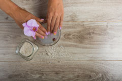 Spa essentials for a manicure. Hand spa essential on wooden background. Beauty concept Stock Photography