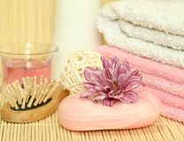 Spa essentials. Towels, soap, flowers. Stock Photo